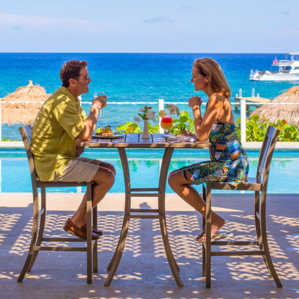 Al fresco dining overlooking the Caribbean makes every mealtime truly special